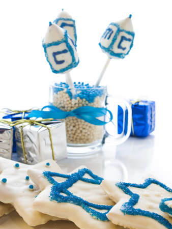 Gourmet dreidels decorated with white icing for Hanukkah. Stock Photo - 15943909
