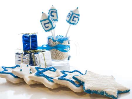 Gourmet dreidels decorated with white icing for Hanukkah. Stock Photo - 15943828