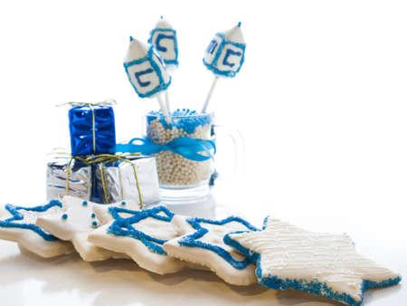 hebrew alphabet: Gourmet dreidels decorated with white icing for Hanukkah.