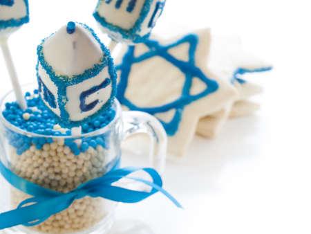 khanukah: Gourmet dreidels decorated with white icing for Hanukkah.