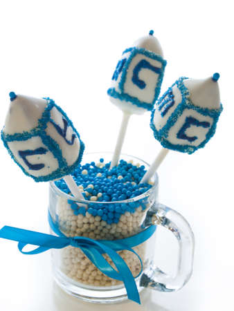 Gourmet dreidels decorated with white icing for Hanukkah. Stock Photo - 15943904