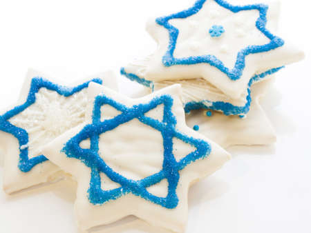 Gourmet cookies decorated with white icing for Hanukkah.