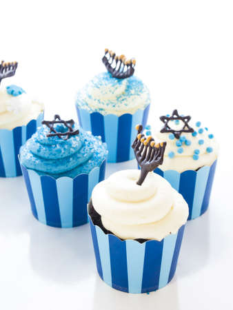 Gourmet cupcakes decorated with white and blue icing for Hanukkah. photo