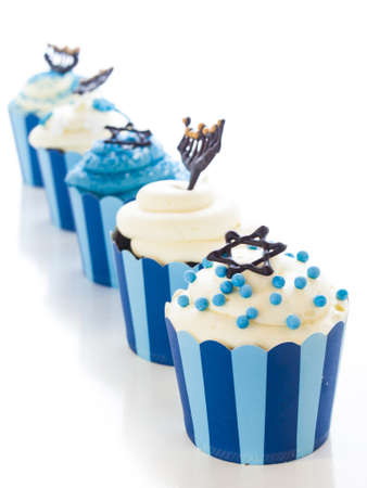 chanukkah: Gourmet cupcakes decorated with white and blue icing for Hanukkah.