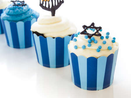 Gourmet cupcakes decorated with white and blue icing for Hanukkah. Stock Photo - 15943836