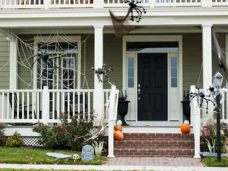 front elevation: A photo of a house decorated for Halloween.
