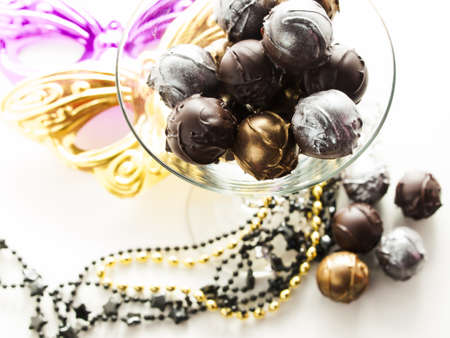 Gourmet champagne truffles derorated for New Year Eve celebration.