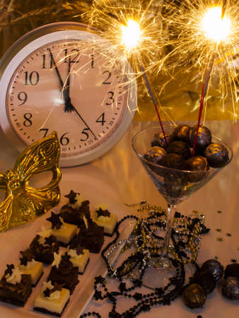 assorted petite: Gourmet champagne truffles and assorted petite party pastries decorated for New Year Eve celebration. Stock Photo