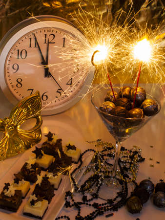 pastrie: Gourmet champagne truffles and assorted petite party pastries decorated for New Year Eve celebration. Stock Photo