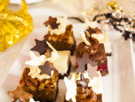 new year eve: Gourmet assorted petite party pastries decorated for New Year Eve celebration.