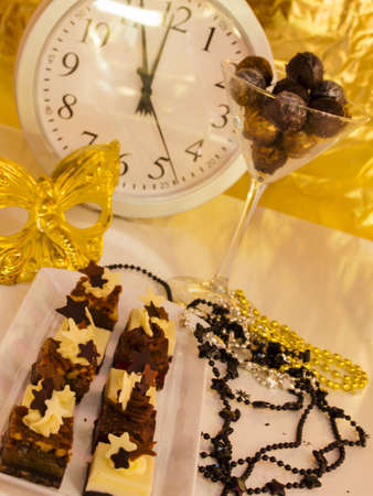 champagne truffles chocolate: Gourmet assorted petite party pastries decorated for New Year Eve celebration.