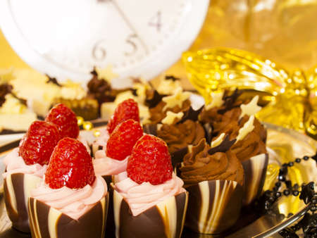pastrie: Gourmet assorted petite party pastries decorated for New Year Eve celebration.