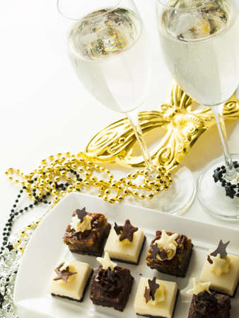 Gourmet assorted petite party pastries decorated for New Year Eve celebration.