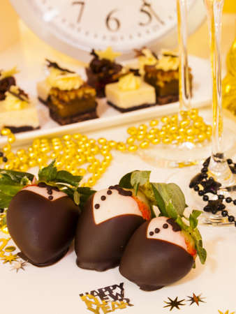 assorted petite: Gourmet assorted petite party pastries decorated for New Year Eve celebration.