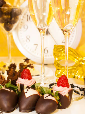 Gourmet assorted petite party pastries decorated for New Year Eve celebration. Stock Photo - 16346601