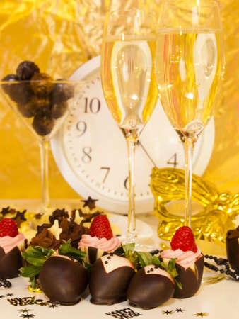 Gourmet assorted petite party pastries decorated for New Year Eve celebration. Stock Photo - 16346433