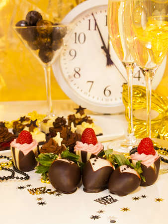Gourmet assorted petite party pastries decorated for New Year Eve celebration. photo