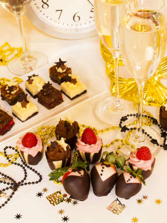 party pastries: Gourmet assorted petite party pastries decorated for New Year Eve celebration.