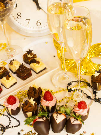 Gourmet assorted petite party pastries decorated for New Year Eve celebration. Stock Photo - 16346728