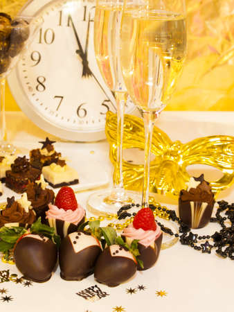 Gourmet assorted petite party pastries decorated for New Year Eve celebration. Stock Photo - 16346725