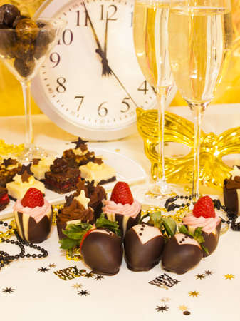 Gourmet assorted petite party pastries decorated for New Year Eve celebration. Stock Photo - 16346711