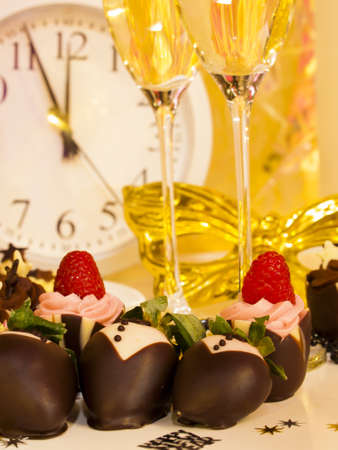 Gourmet assorted petite party pastries decorated for New Year Eve celebration. Stock Photo - 16346246
