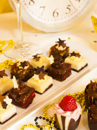 airy texture: Gourmet assorted petite party pastries decorated for New Year Eve celebration.