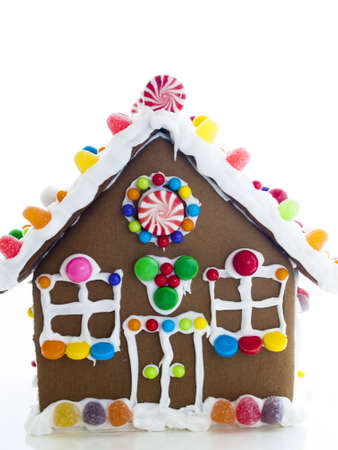 Decorated gingerbread house on white background. photo