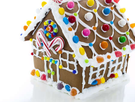 Decorated gingerbread house on white background.