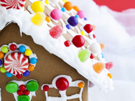 gingerbread: Decorated gingerbread house on red background.