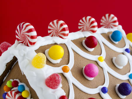 Decorated gingerbread house on red background. photo