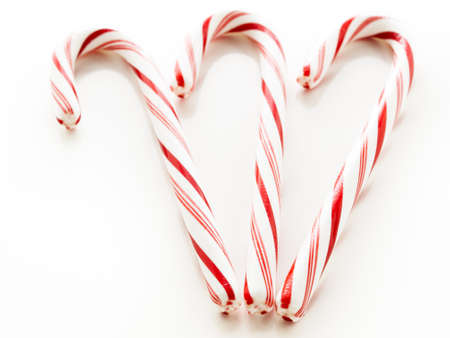 peppermint candy: White and red peppermint candy cane on white background.