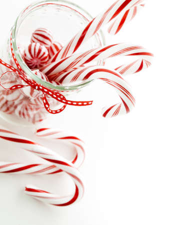 Gourmet white and red peppermint candies on white background. photo
