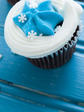 Gourmet chocolate cupcakes with white and blue icing. photo