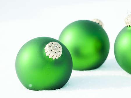 Christmas ornaments in virgin snow. 版權商用圖片