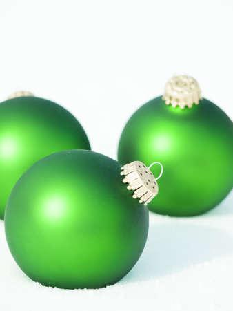 Christmas ornaments in virgin snow. Imagens