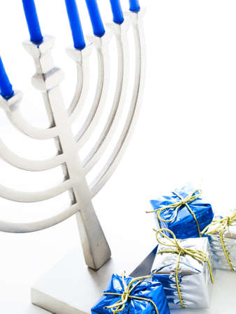 Contemporary menorah with blue candels on white background. Stock Photo - 16634630