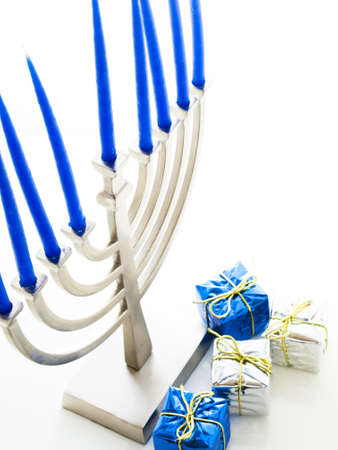 Contemporary menorah with blue candels on white background. Stock Photo - 16634596