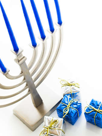 Contemporary menorah with blue candels on white background. Stock Photo - 16634620