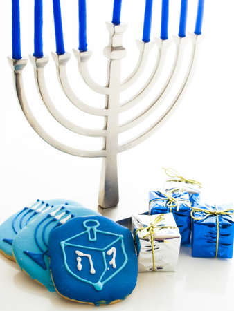 Contemporary menorah with blue candels on white background. Stock Photo - 16634635