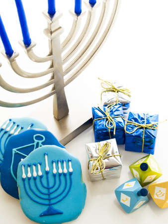 Contemporary menorah with blue candels on white background. Stock Photo