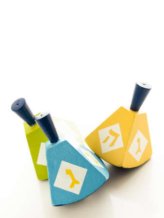 Colorful dreidels on white background. photo
