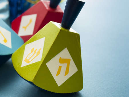 Colorful dreidels on blue background. photo