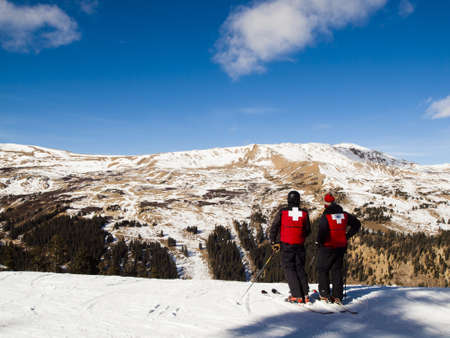 Ski patrol in red jackets on top of Loveland Ski Basin.