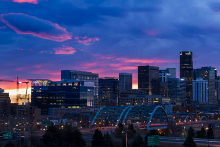 riverfront: Beautiful sunrise with blue and pink sky over the mile high city of Denver, Colorado. Editorial