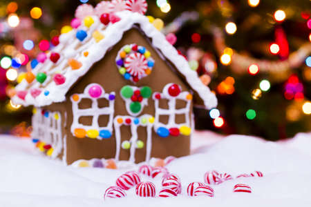 gingerbread: Gingerbread house with round  peppermint candies.