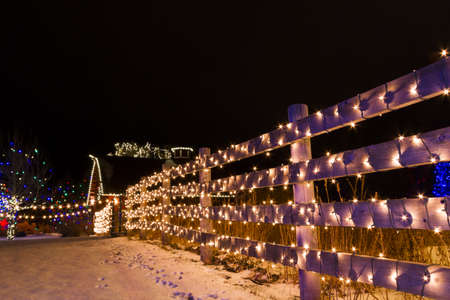 denver botanical gardens: Historic farm decorated with Christmas lights.