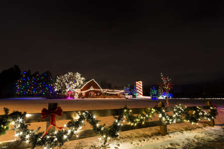 Historic farm decorated with Christmas lights.