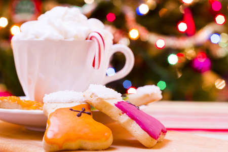 Colorful Christmas sugar cookies with hot chocolate.