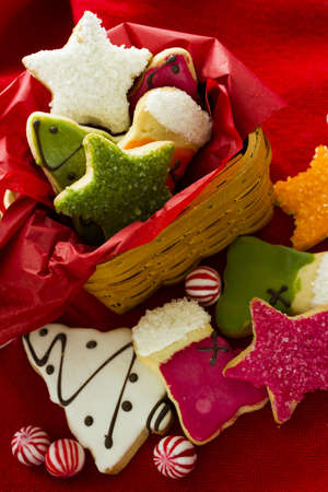 Assorted christmas cookies on red background. photo